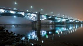 Bridge illuminated at night in the fog Stock Photo