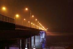 Bridge with illumination during snowfall at winter Royalty Free Stock Photo