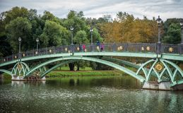Bridge inside Tsaritsyno park with colorful tree Stock Photos