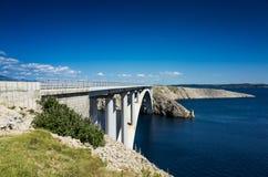 Bridge on island Pag Croatia Europe. Pag Croatia Europe. Beautiful nature and landscape photo of Adriatic Sea and high bridge. Nice colorful warm summer day Royalty Free Stock Images
