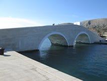 Bridge in island Pag. Bridge, island, sea, build, architecture Royalty Free Stock Photo