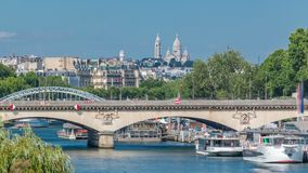 Bridge Jena and Basilica du Sacre-Coeur timelapse. Paris, France. It connects the Champ de Mars and the Trocadero gardens. It is named after the town of Jena stock video footage