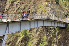 Bridge Jumping in Banos, Ecuador. BANOS, ECUADOR - FEBRUARY 26, 2014: Unidentified people at bridge jumping (puenting) on San Francisco Bridge on February 26 Royalty Free Stock Photography