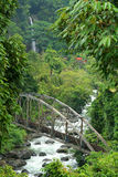 Bridge In The Jungle. Bridge over river in jungle in Indonesia stock photos
