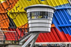 Bridge keeper`s cabin and colorful bridge deck. Haarlem, The Netherlands, June 24, 2017: bridge keeper`s cabin of the Langebrug across the Spaarne river, against stock photography