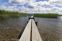 Wooden pier over lake Stock Image
