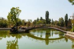 The bridge on the lake in city park Stock Photos