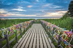 Bridge on the lake with colorful ribbons royalty free stock photography