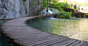 Bridge through lake in deep forest. Crystal clear water. Plitvic Royalty Free Stock Photography