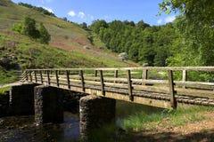 Bridge lake district. Hills bridge river stream tree heather heath moor flood summer sunny peace tranquil tranquility lake district Stock Photo