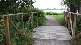 Bridge by lake. A bridge by a like in Växjö Sweden stock images