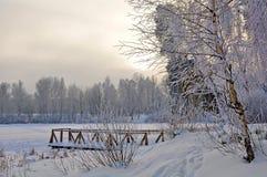 Bridge on the lake in the snow Stock Photo
