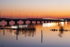 Bridge and Lake at sunset Royalty Free Stock Photo