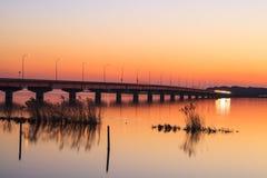 Bridge and Lake at sunset Royalty Free Stock Image