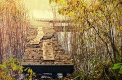 Bridge in lake Stock Images