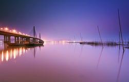 Bridge and lakes in night sky Stock Photo