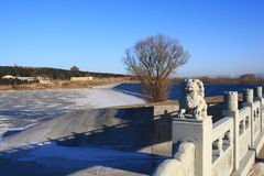 Bridge  and the landscape. Stone lion statue and the park, ancient chinese park Stock Image