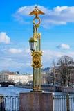 Bridge Lantern in St.Petersburg, Russia. Ornate decorated lantern on Pantaleon Bridge over Fontanka river in a historical part of St.Petersburg, Russia Royalty Free Stock Photos