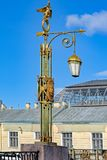 Bridge Lantern in St.Petersburg, Russia. Ornate decorated lantern on Pantaleon Bridge over Fontanka river in a historical part of St.Petersburg, Russia Royalty Free Stock Photo