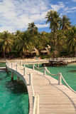 Bridge lead to tropical beach Royalty Free Stock Photo