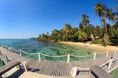 Bridge lead to tropical beach Royalty Free Stock Image