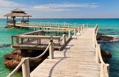 Bridge lead to tropical beach Stock Photo