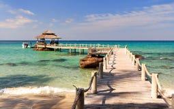 Bridge lead to tropical beach Stock Image