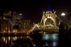 Bridge leading to downtown. A suspension bridge leading to downtown Pittsburgh, PA Stock Photos