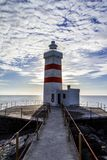 Bridge leading to the lighthouse. Iceland. Vertical Royalty Free Stock Photos