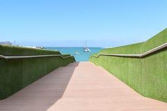 Bridge leading to the ocean Royalty Free Stock Photo