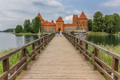Bridge leading to the red brick castl in Trakai Royalty Free Stock Photography