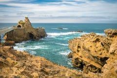 Bridge leading to scenic rocher de la vierge on atlantic coastline in colorful amazing seascape, Biarritz, Basque Country, France Stock Images