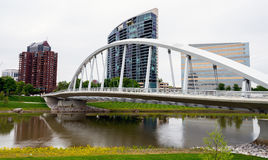 Bridge leads over the Scioto River in Columbus Ohio. Fancy bridge in Columbus Ohio and tall buildings Royalty Free Stock Photos