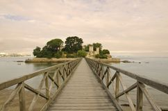 Bridge right to the castle. This bridge leads to the castle located in a small island near the seashore of Galicia. Spain royalty free stock photo