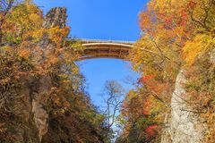 Bridge with leaves turning color in autumn in Naruko Gorge - Osaki, Miyagi, Japan stock images