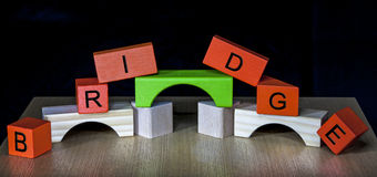 Bridge - in letters and bricks.  royalty free stock images