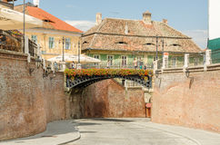 The Bridge Of Lies In Sibiu. SIBIU, ROMANIA - AUGUST 25: The Bridge Of Lies on August 25, 2013 in Sibiu, Romania. Built in 1859 the oldest cast iron bridge it is Stock Images