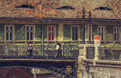 Bridge of lies, Sibiu, Romania. Sibiu, Romania - 06 May, 2015: Unidentified people visit the Bridge Of Lies that connects the Small Square with Huet Square in Royalty Free Stock Images