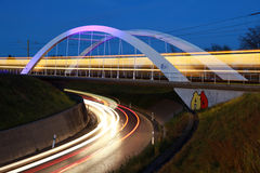 Bridge for light rail near Stuttgart. The bridge for light rails in Ostfildern near Stuttgart in Germany is illuminated at night royalty free stock images