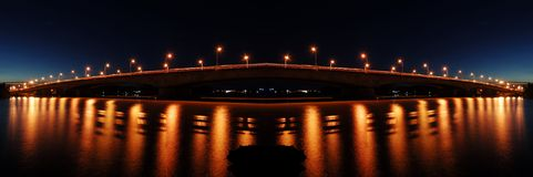 Bridge Lighting Reflection. River reflection of the bridge street lighting at night royalty free stock photos