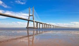 Bridge in Lisbon. Vasco da Gama bridge in Lisbon, Portugal. On Blue Sky Stock Photo
