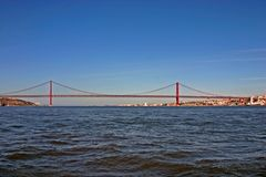 Bridge in Lisbon from the water Stock Photos