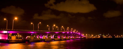 Bridge lit up at night Stock Images