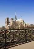 The bridge with locks and Notre-Dame. France. Paris Stock Photography