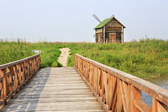 Bridge of love and an old mill. Tourist Complex Siberian Podvorye. Stock Image