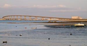 Bridge at low tide Stock Images