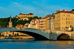 A bridge at Lyon France. A view from the water up towards a bridge in Lyon France showing some of the old colourful buildings stock image
