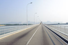 Bridge in Macao. Traffic on one of bridge in Macao, ex-colony of Portugal Royalty Free Stock Image