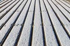 The bridge made of plank with snow Royalty Free Stock Photos