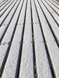 The bridge made of plank with snow portrait orientation royalty free stock images